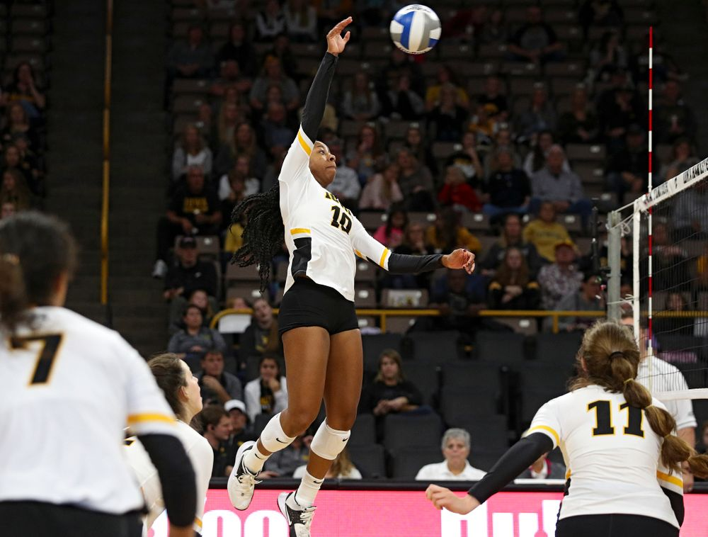 Iowa's Griere Hughes (10) sends over a shot during the second set of their volleyball match at Carver-Hawkeye Arena in Iowa City on Sunday, Oct 13, 2019. (Stephen Mally/hawkeyesports.com)