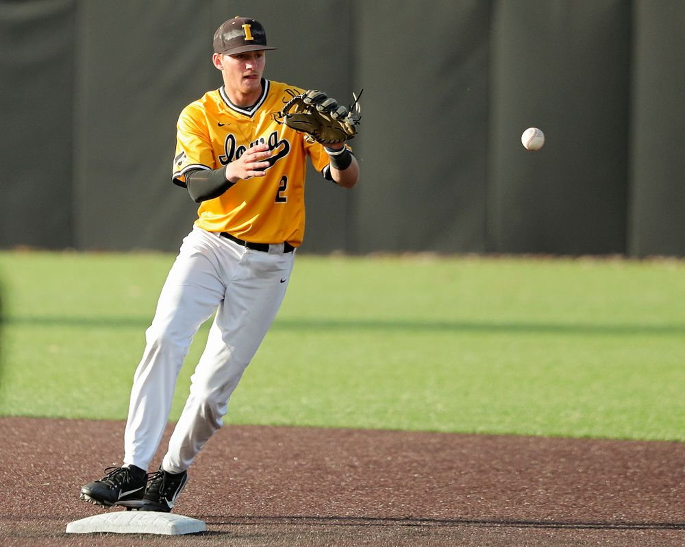 Iowa infielder Brendan Sher (2) pulls in a throw as he turns a double play during the fourth inning of the first game of the Black and Gold Fall World Series at Duane Banks Field in Iowa City on Tuesday, Oct 15, 2019. (Stephen Mally/hawkeyesports.com)