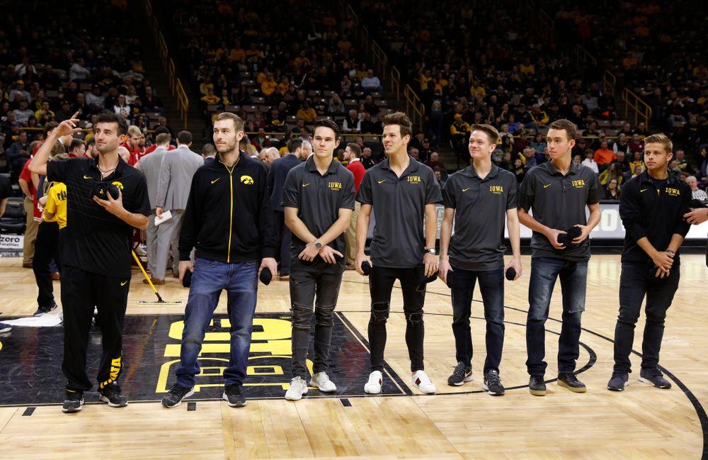 The Iowa Men's Tennis Team throws out t-shirts