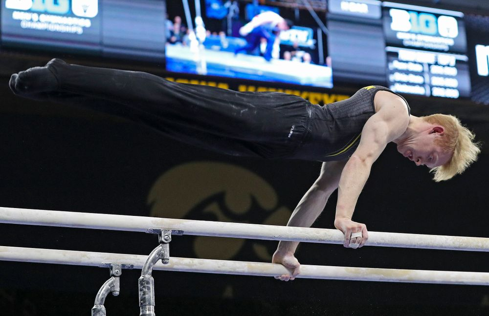 Iowa's Nick Merryman competes in the parallel bars during the first day of the Big Ten Men's Gymnastics Championships at Carver-Hawkeye Arena in Iowa City on Friday, Apr. 5, 2019. (Stephen Mally/hawkeyesports.com)