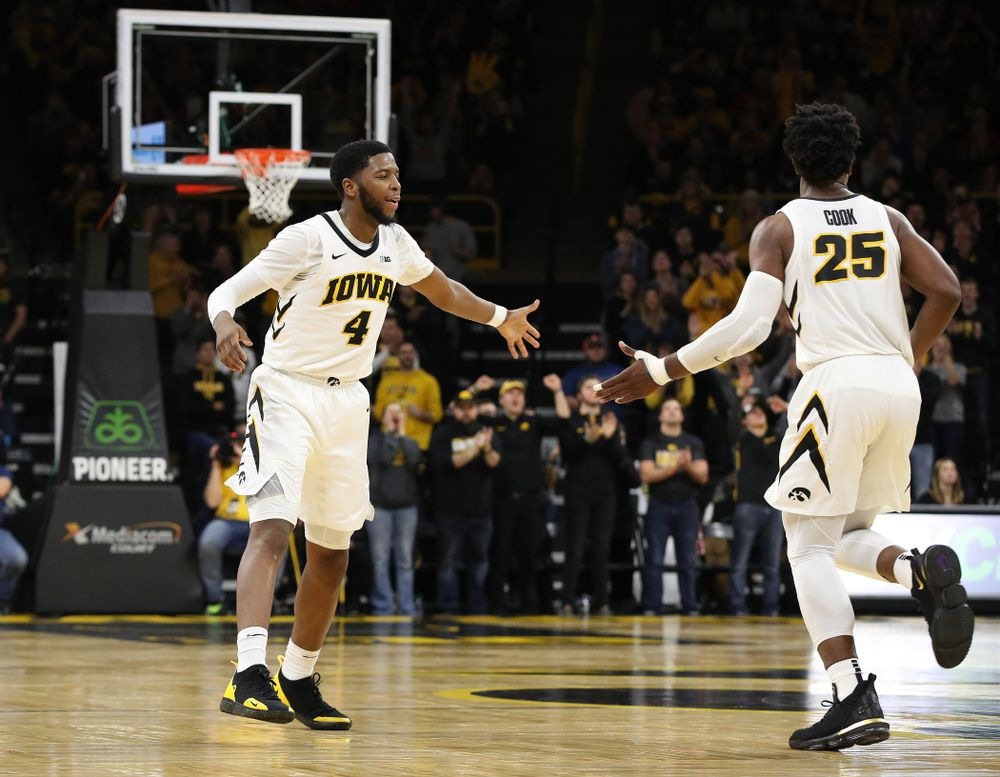 Iowa Hawkeyes guard Isaiah Moss (4) and forward Tyler Cook (25) against the Ohio State Buckeyes Saturday, January 12, 2019 at Carver-Hawkeye Arena. (Brian Ray/hawkeyesports.com)