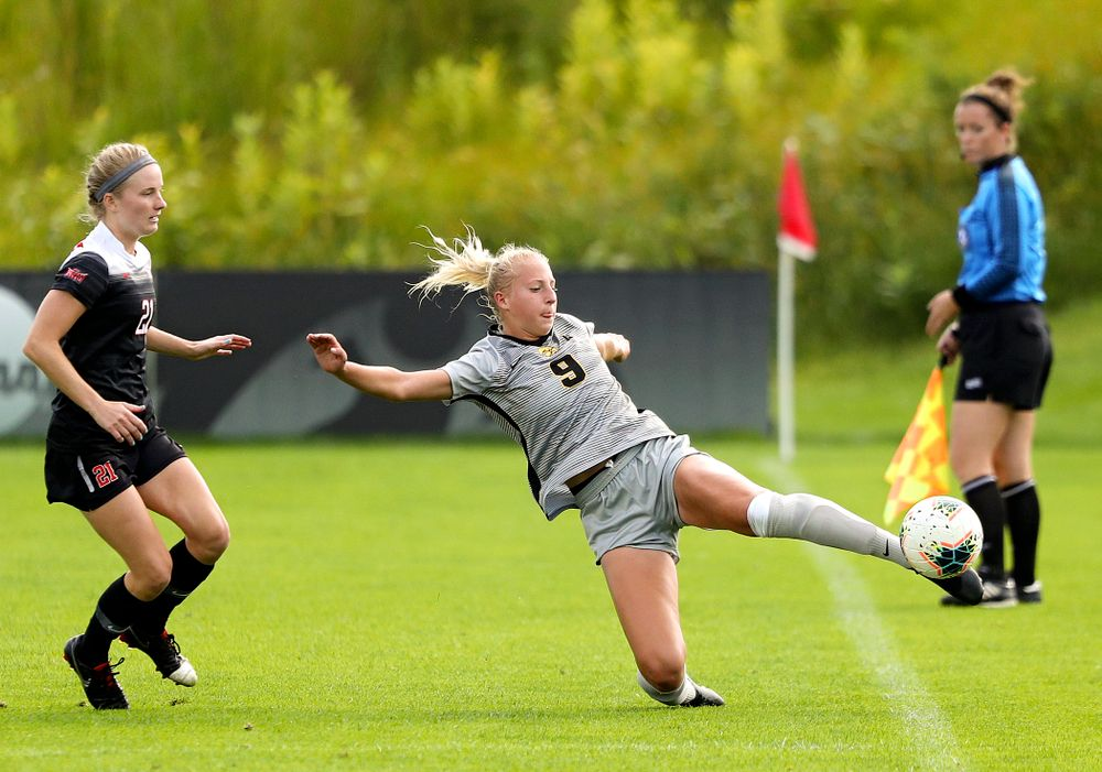 Iowa defender Samantha Cary (9) tries to reach the ball during the first half of their match at the Iowa Soccer Complex in Iowa City on Sunday, Sep 1, 2019. (Stephen Mally/hawkeyesports.com)