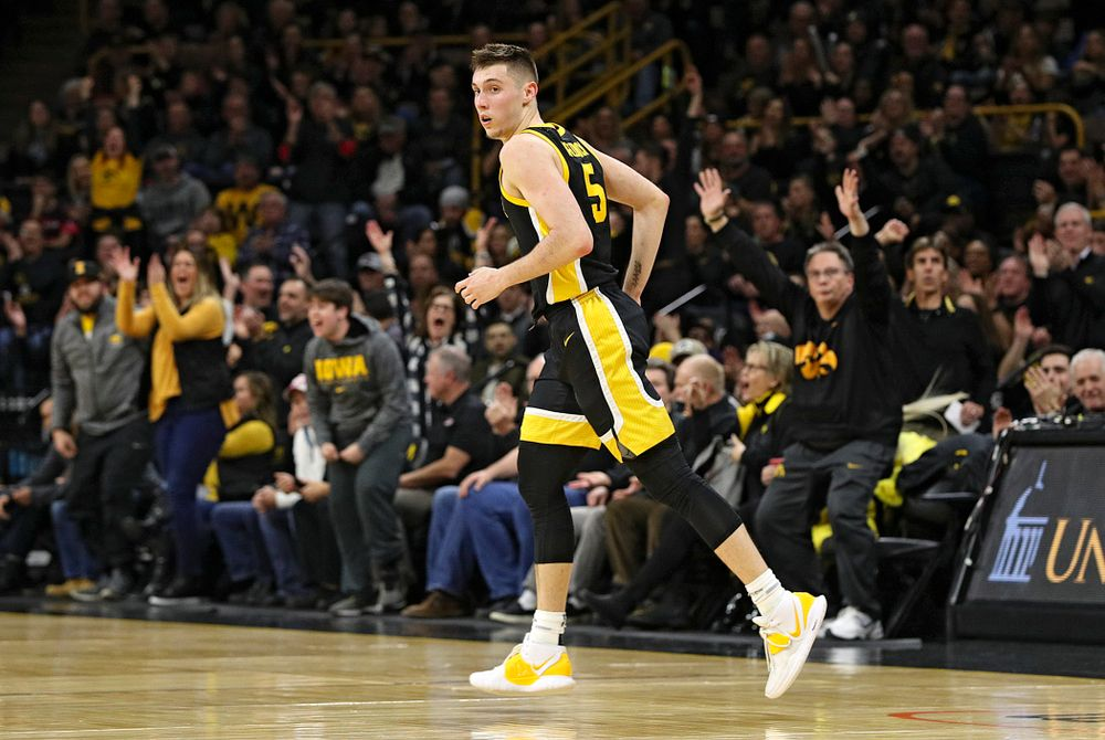 Iowa Hawkeyes guard CJ Fredrick (5) runs down the court after making a 3-pointer during the first half of their game at Carver-Hawkeye Arena in Iowa City on Monday, January 27, 2020. (Stephen Mally/hawkeyesports.com)