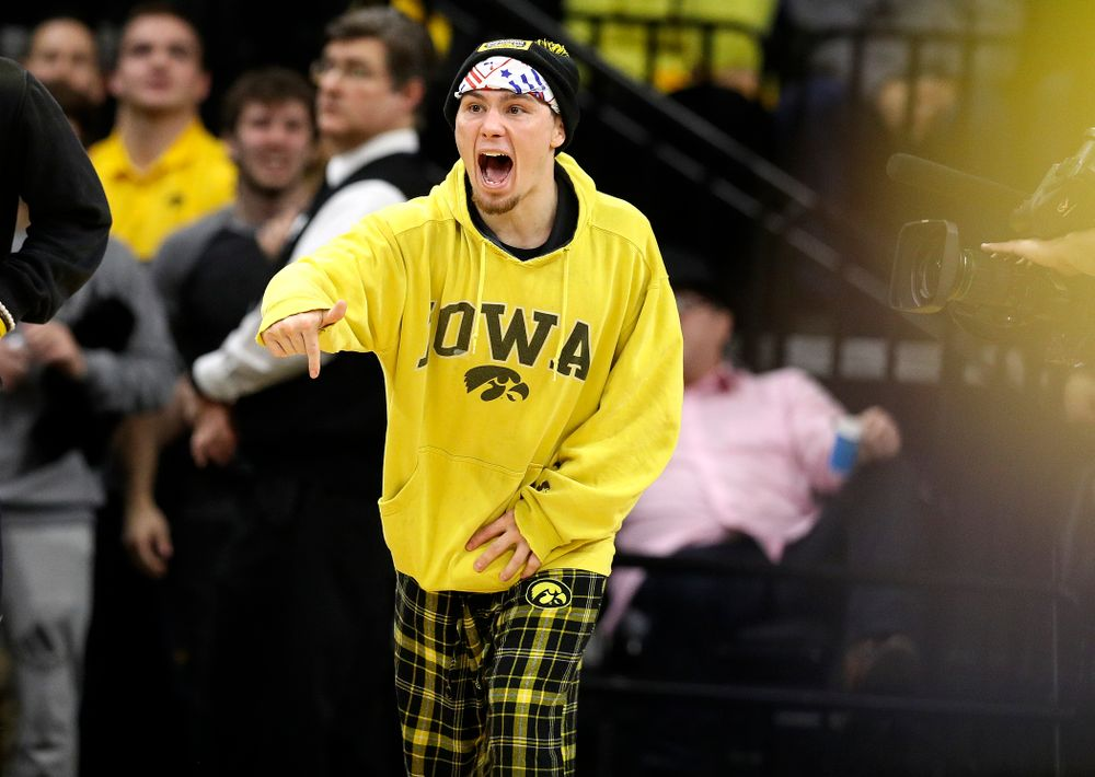 Iowa's Spencer Lee cheers on Michael Kemerer in his 174-pound match during their dual at Carver-Hawkeye Arena in Iowa City on Friday, January 31, 2020. (Stephen Mally/hawkeyesports.com)