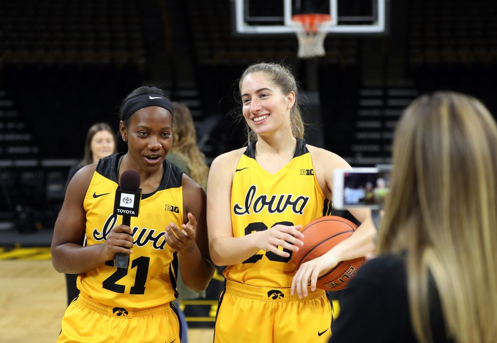 Iowa Hawkeyes guard Zion Sanders (21) and guard Kate Martin (20) during the teamÕs annual media day Thursday, October 24, 2019 at Carver-Hawkeye Arena. (Brian Ray/hawkeyesports.com)