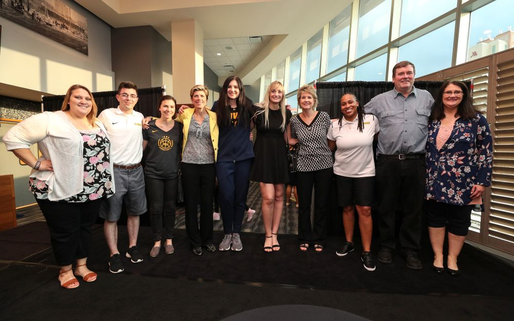 Iowa Hawkeyes forward and AP Player of the Year Megan Gustafson (10) and the Iowa Women's Basketball Staff following a news conference Thursday, April 4, 2019 at Amalie Arena in Tampa, FL. (Brian Ray/hawkeyesports.com)