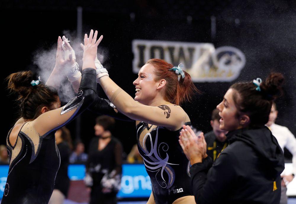 Iowa's Maria Ortiz competes on the bars against the Nebraska Cornhuskers