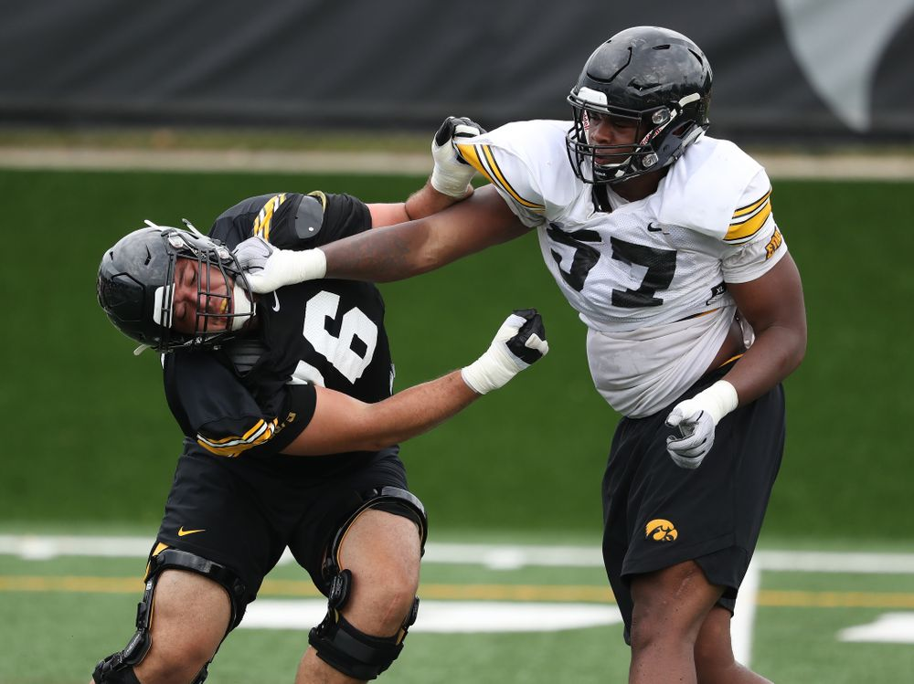 Iowa Hawkeyes offensive lineman Dalton Ferguson (76) and defensive end Chauncey Golston (57) during practice No. 4 of Fall Camp Monday, August 6, 2018 at the Hansen Football Performance Center. (Brian Ray/hawkeyesports.com)