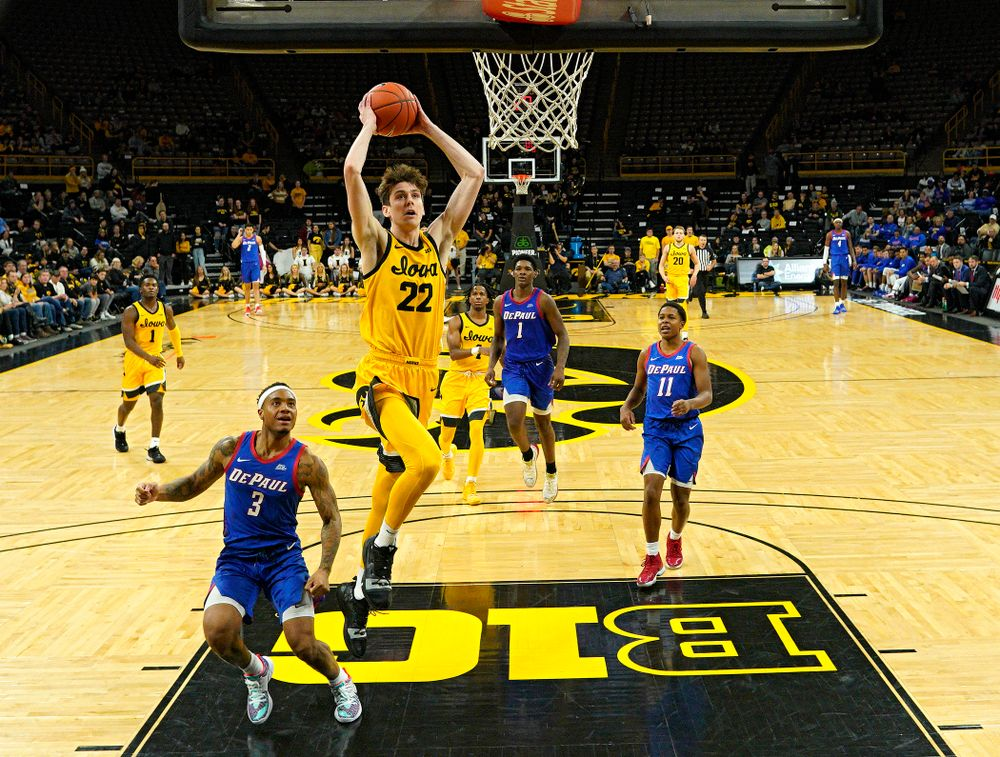 Iowa Hawkeyes forward Patrick McCaffery (22) dunks the ball during the second half of their game at Carver-Hawkeye Arena in Iowa City on Monday, Nov 11, 2019. (Stephen Mally/hawkeyesports.com)