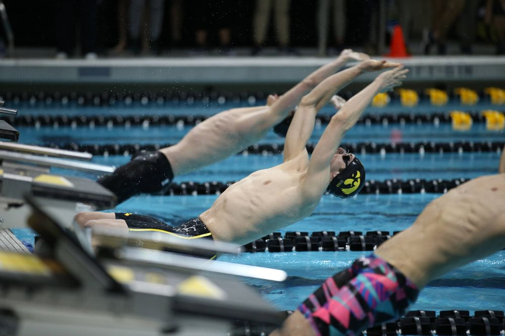 The Iowa A team competes in the 200-yard medley relay at the 2019 Big Ten Swimming and Diving meet  Wednesday, February 27, 2019 at the Campus Wellness and Recreation Center. (Lily Smith/hawkeyesports.com)