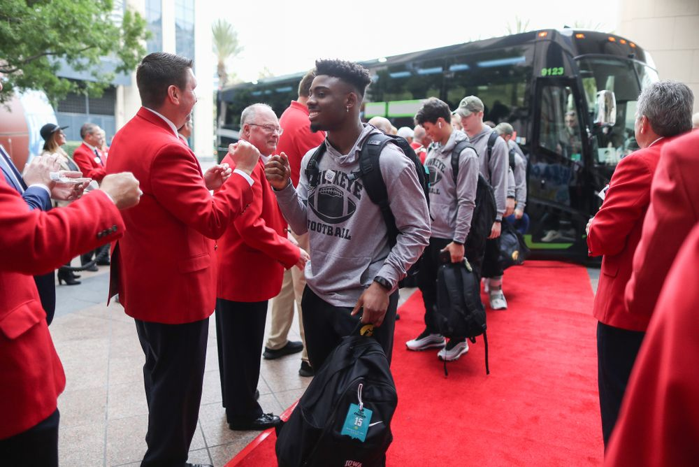 Iowa Hawkeyes running back Tyler Goodson (15) shakes hands with the ÒRed CoatsÓ after arriving in San Diego, CA Saturday, December 21, 2019 for the Holiday Bowl. (Brian Ray/hawkeyesports.com)