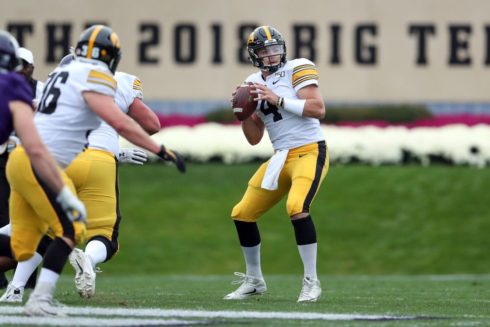 Iowa Hawkeyes quarterback Nate Stanley (4) against the Northwestern Wildcats Saturday, October 26, 2019 at Ryan Field in Evanston, Ill. (Brian Ray/hawkeyesports.com)