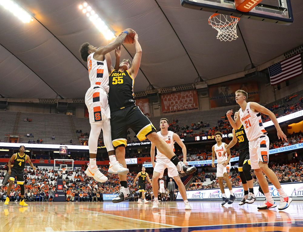 Iowa Hawkeyes center Luka Garza (55) battles for a rebound during the second half of their ACC/Big Ten Challenge game at the Carrier Dome in Syracuse, N.Y. on Tuesday, Dec 3, 2019. (Stephen Mally/hawkeyesports.com)