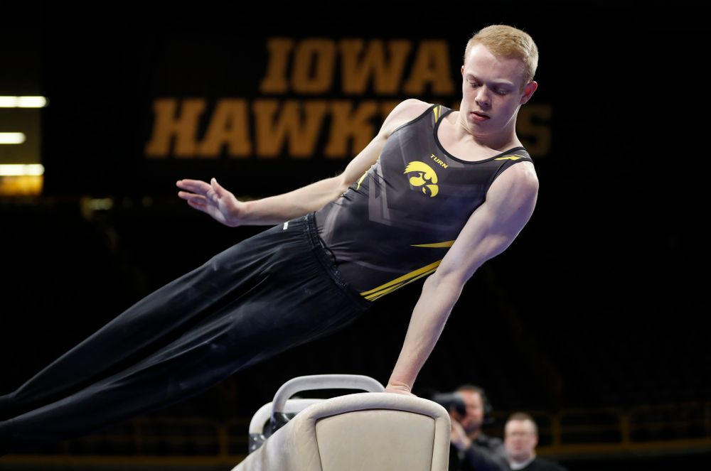 Iowa's Nick Merryman competes on the pommel horse