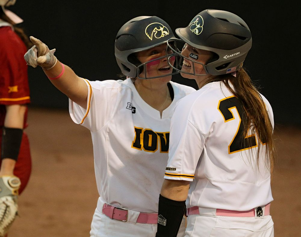 Iowa catcher Abby Lien (from left) talks with Miranda Schulte before Schulte's at bat during the fifth inning of their game against Iowa State at Pearl Field in Iowa City on Tuesday, Apr. 9, 2019. (Stephen Mally/hawkeyesports.com)