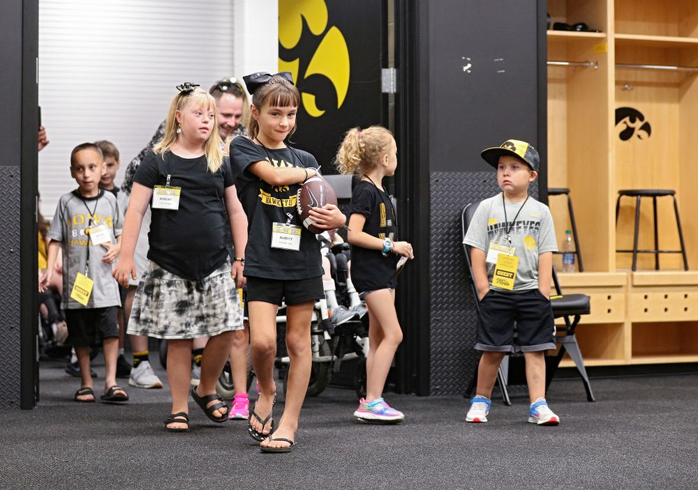 Kid Captains enter the Iowa locker room during Kids Day at Kinnick Stadium in Iowa City on Saturday, Aug 10, 2019. (Stephen Mally/hawkeyesports.com)