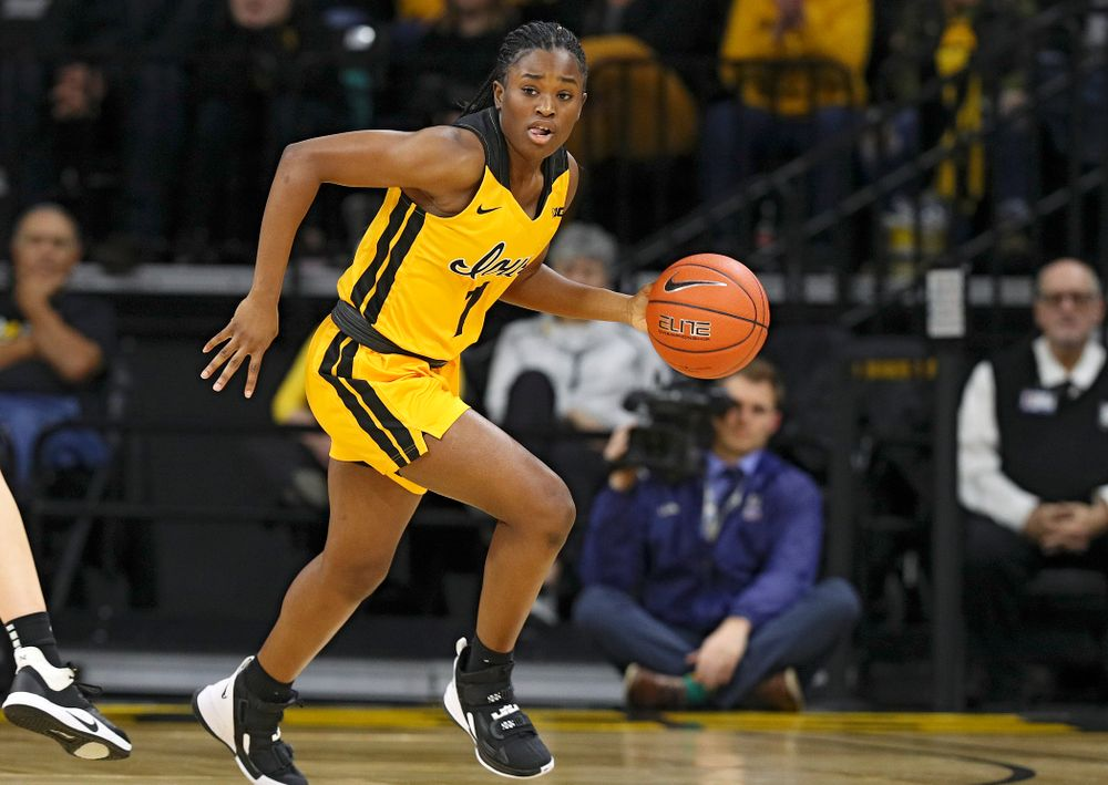 Iowa Hawkeyes guard Tomi Taiwo (1) brings the ball down the court during the second quarter of their game at Carver-Hawkeye Arena in Iowa City on Thursday, January 23, 2020. (Stephen Mally/hawkeyesports.com)