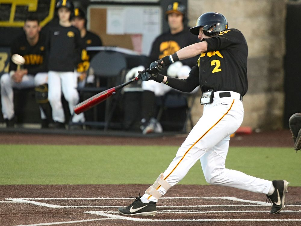 Iowa infielder Brendan Sher (2) drives a pitch for a hit during the fifth inning of their game at Duane Banks Field in Iowa City on Tuesday, March 3, 2020. (Stephen Mally/hawkeyesports.com)