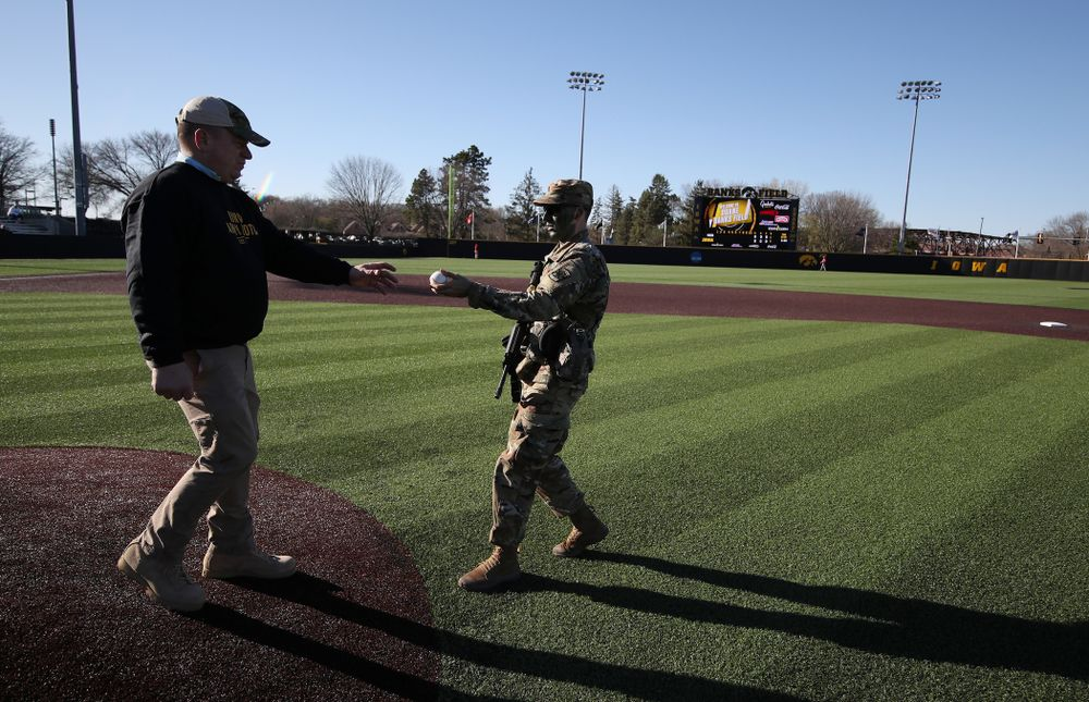 Members of the University of Iowa ROTC deliver the game ball before the Iowa Hawkeyes game against the Nebraska Cornhuskers on Military Appreciation Night Friday, April 19, 2019 at Duane Banks Field. (Brian Ray/hawkeyesports.com)