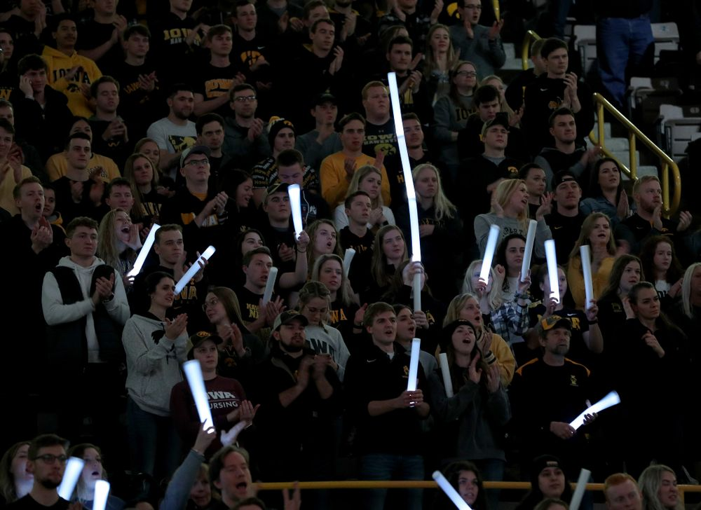 Fans wave glow sticks as the Iowa Hawkeyes wrestle Ohio State Friday, January 24, 2020 at Carver-Hawkeye Arena. (Brian Ray/hawkeyesports.com)
