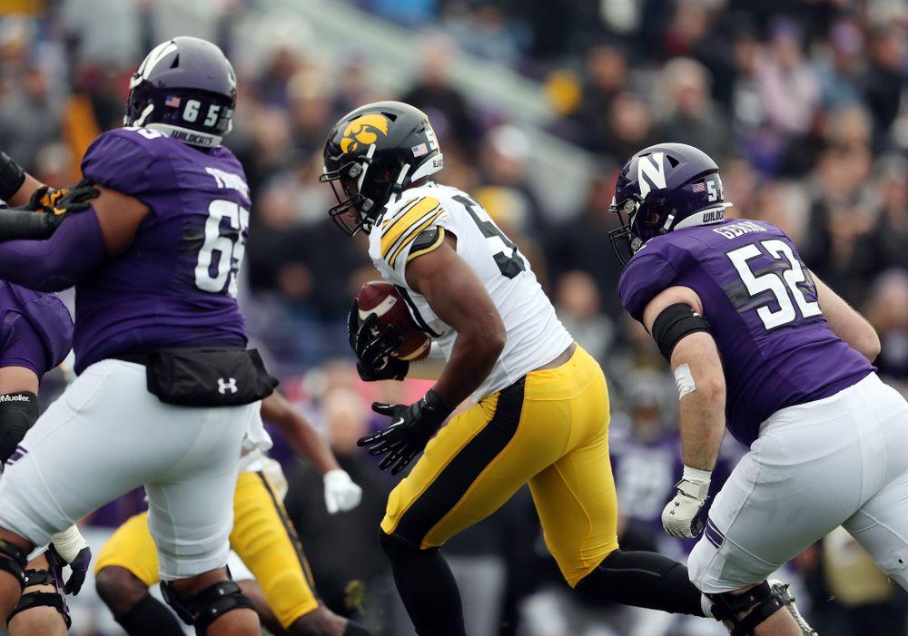 Iowa Hawkeyes defensive end Chauncey Golston (57) intercepts a pass against the Northwestern Wildcats Saturday, October 26, 2019 at Ryan Field in Evanston, Ill. (Brian Ray/hawkeyesports.com)