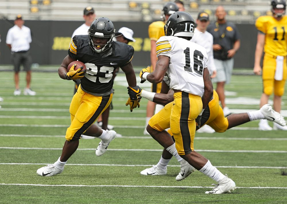 Iowa Hawkeyes running back Shadrick Byrd (23) tries to get around the end during Fall Camp Practice No. 8 at Kids Day at Kinnick Stadium in Iowa City on Saturday, Aug 10, 2019. (Stephen Mally/hawkeyesports.com)