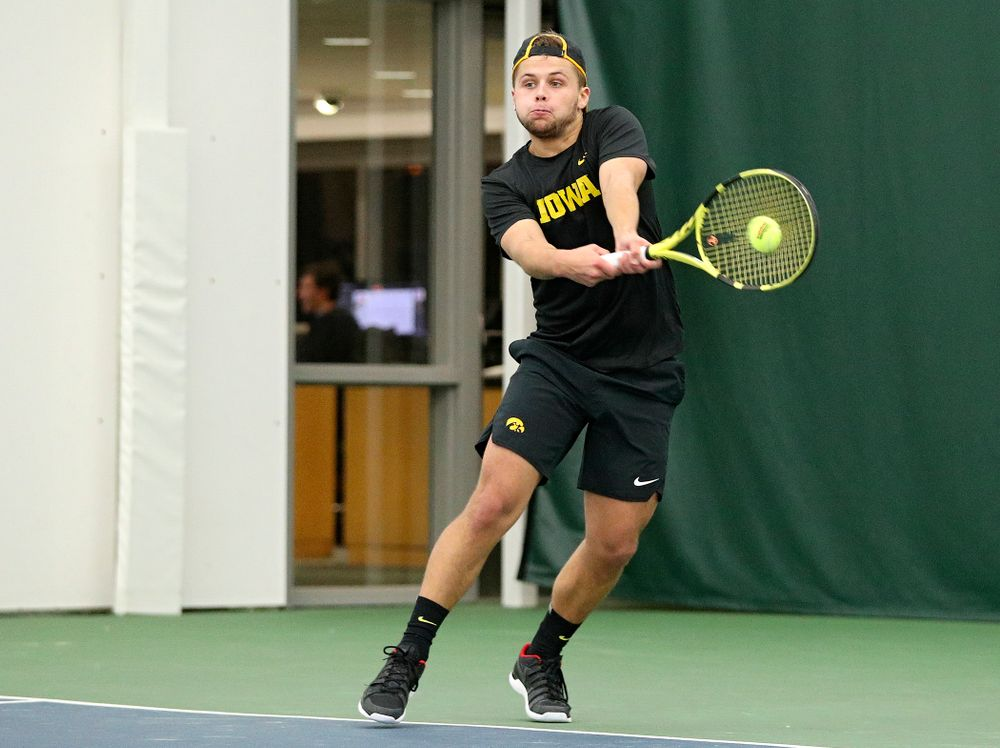 Iowa's Will Davies returns a shot during their match at the Hawkeye Tennis and Recreation Complex in Iowa City on Thursday, January 16, 2020. (Stephen Mally/hawkeyesports.com)