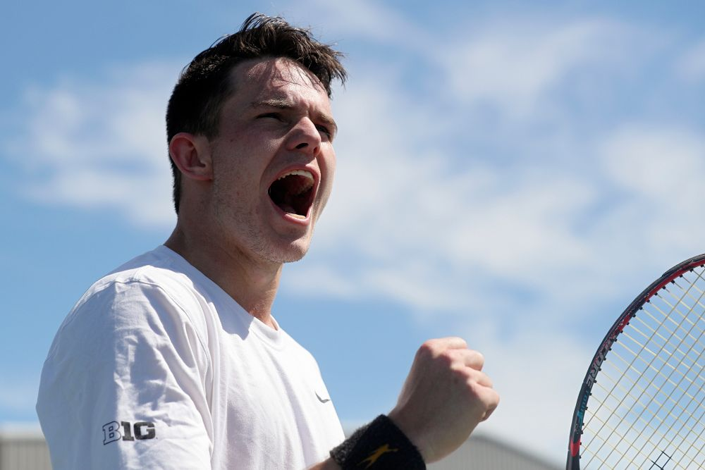 Iowa's Jonas Larson shouts during his match against Michigan at the Hawkeye Tennis and Recreation Complex in Iowa City on Sunday, Apr. 21, 2019. (Stephen Mally/hawkeyesports.com)