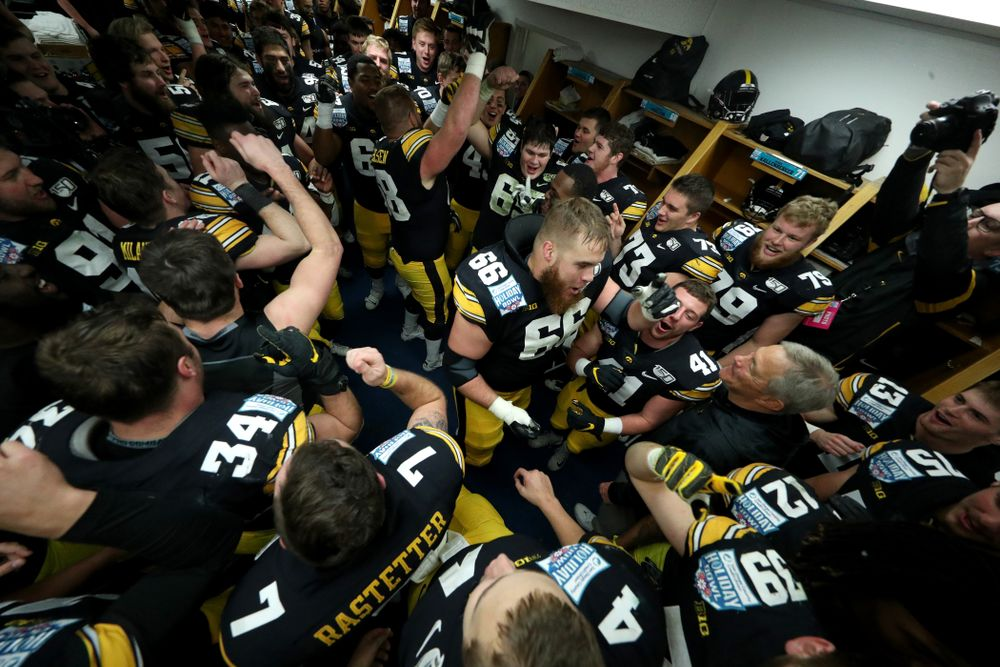 The Iowa Hawkeyes do the Hokey Pokey in the locker room to honor the late Hayden Fry following their win against USC in the Holiday Bowl Saturday, December 28, 2019 at San Diego Community Credit Union Stadium.  (Brian Ray/hawkeyesports.com)