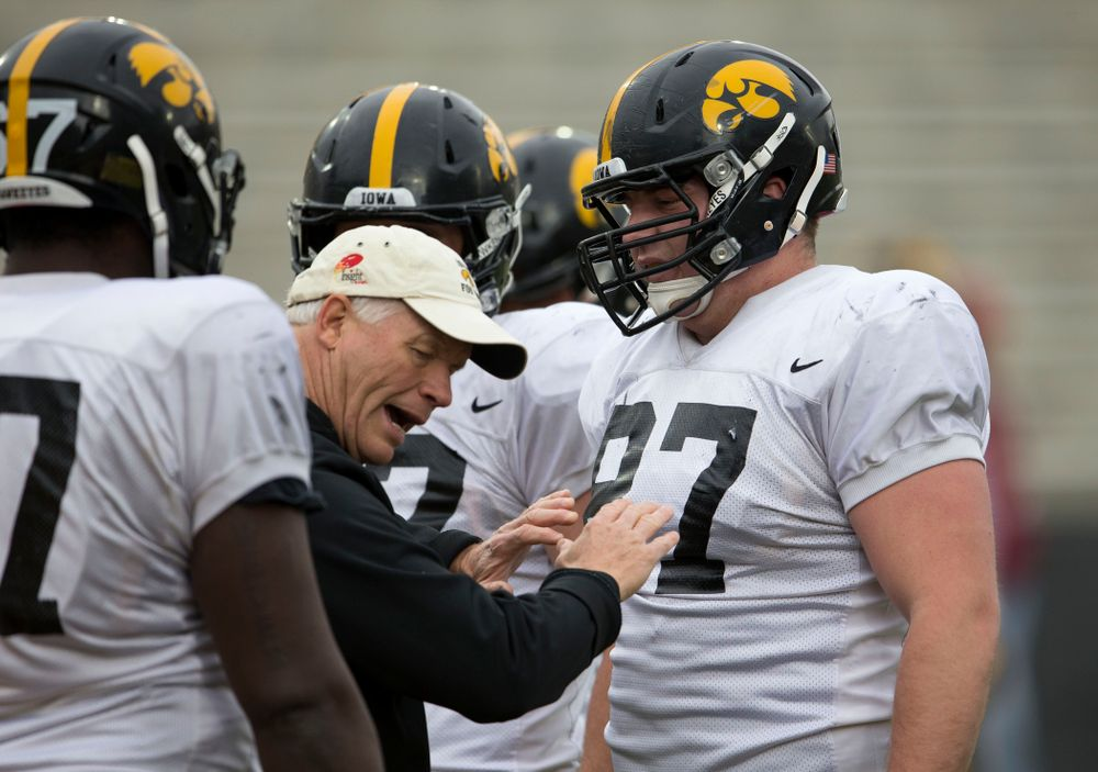 Iowa Hawkeyes defensive line coach Reese Morgan works with defensive lineman Wil Rathjen (87) during spring practice Wednesday, April 16, 2014 at the Kinnick Stadium in Iowa City.  (Brian Ray/hawkeyesports.com)