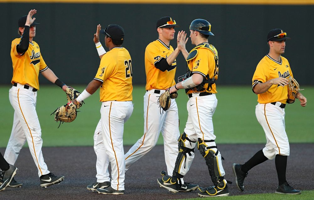 The Iowa Hawkeyes celebrate after winning their game against Northern Illinois at Duane Banks Field in Iowa City on Tuesday, Apr. 16, 2019. (Stephen Mally/hawkeyesports.com)