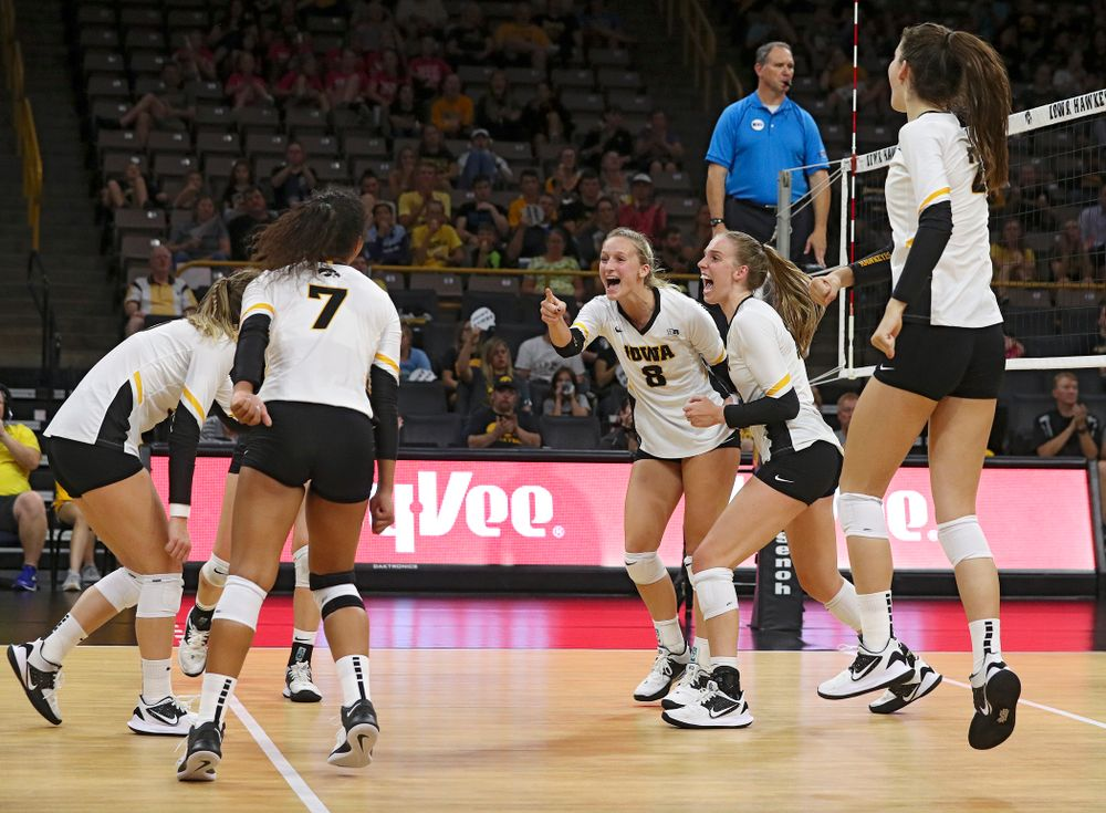 Iowa's Kyndra Hansen (8) points at Brie Orr (7) after her kill with an assist by Orr during the third set of their Big Ten/Pac-12 Challenge match against Colorado at Carver-Hawkeye Arena in Iowa City on Friday, Sep 6, 2019. (Stephen Mally/hawkeyesports.com)