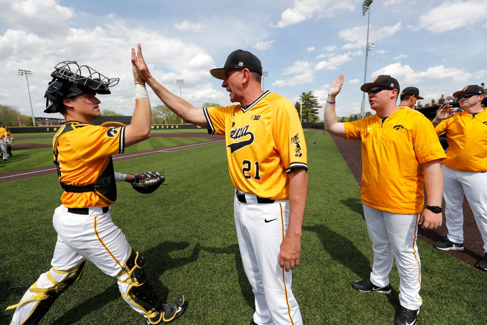 Iowa Hawkeyes catcher Tyler Cropley (5) and head coach Rick Heller against the Oklahoma State Cowboys Sunday, May 6, 2018 at Duane Banks Field. (Brian Ray/hawkeyesports.com)