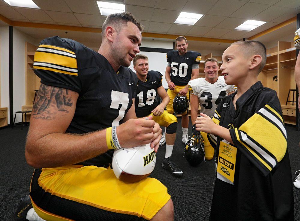 Iowa Hawkeyes punter Colten Rastetter (7) talks with  2019 Kid Captain Skylar Hardee during Kids Day at Kinnick Stadium in Iowa City on Saturday, Aug 10, 2019. (Stephen Mally/hawkeyesports.com)