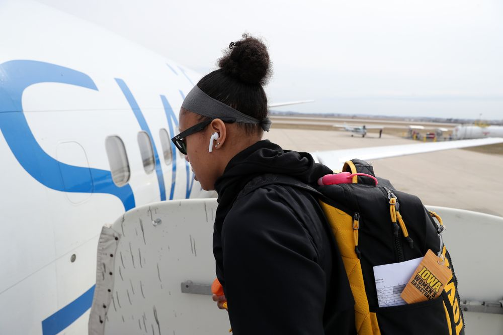 Iowa Hawkeyes guard Tania Davis (11) boards the team plane to Greensboro, NC for the Regionals of the 2019 NCAA Women's Basketball Championships Thursday, March 28, 2019 at the Eastern Iowa Airport. (Brian Ray/hawkeyesports.com)