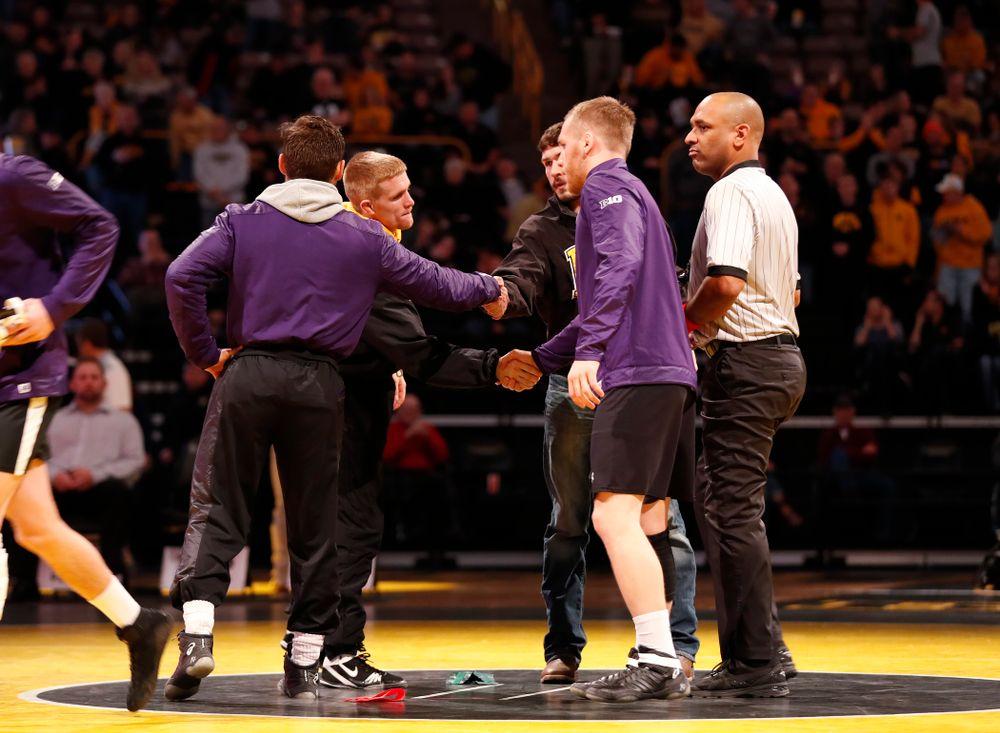 Iowa Hawkeyes captains Phillip Laux and Logan McQuillen before their meet against Northwestern