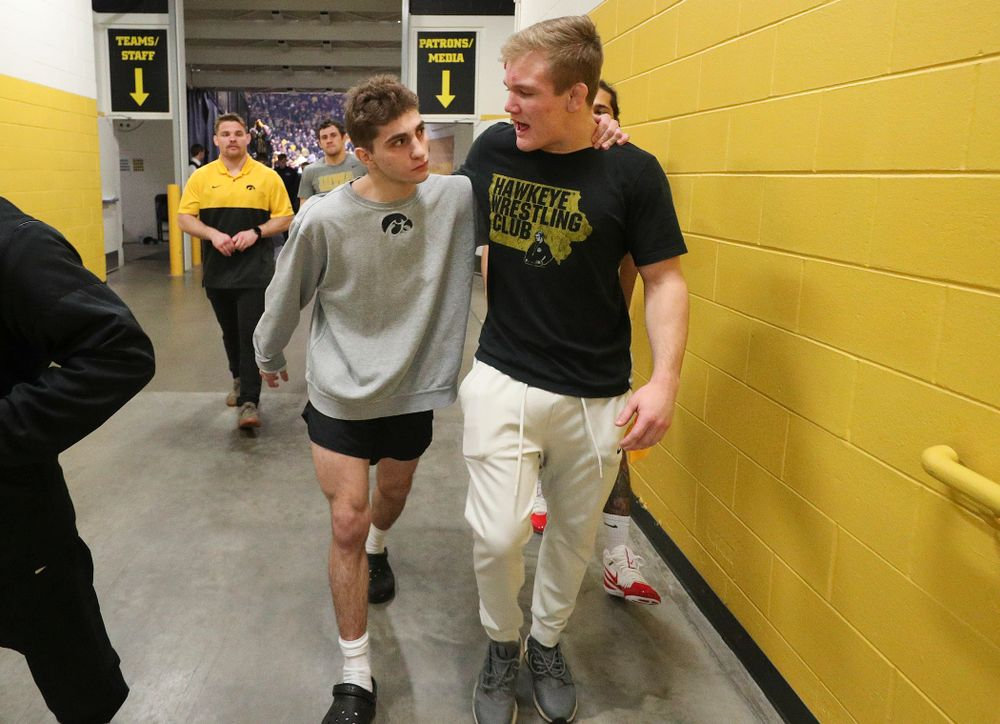 Iowa's Austin DeSanto (from left) talks with Nelson Brands after their dual at Carver-Hawkeye Arena in Iowa City on Friday, January 31, 2020. (Stephen Mally/hawkeyesports.com)
