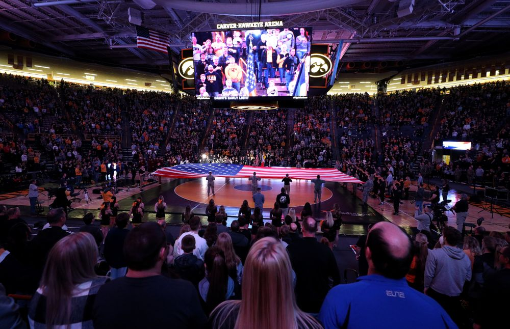 Members of the military spread out a large flag during the National Anthem before the Iowa Hawkeyes meet against Minnesota Saturday, February 15, 2020 at Carver-Hawkeye Arena. (Brian Ray/hawkeyesports.com)