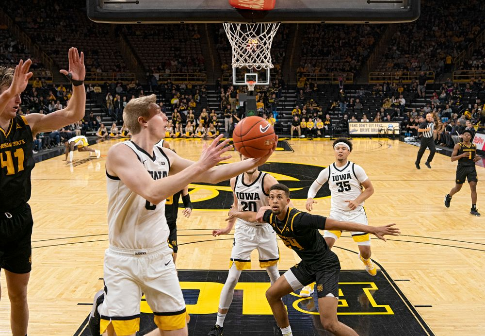 Iowa Hawkeyes forward Michael Baer (0) scores a basket during the second half of their their game at Carver-Hawkeye Arena in Iowa City on Sunday, December 29, 2019. (Stephen Mally/hawkeyesports.com)