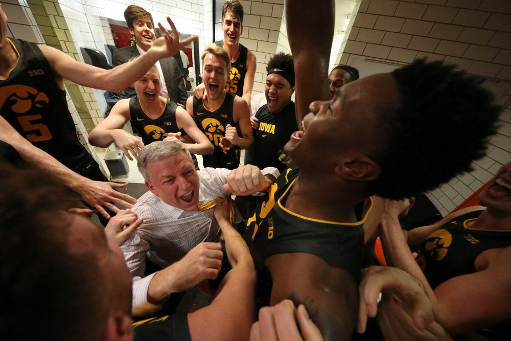Iowa Hawkeyes assistant coach Kirk Speraw dances with the players as they celebrate their win against the Iowa State Cyclones Thursday, December 12, 2019 at Hilton Coliseum in Ames, Iowa(Brian Ray/hawkeyesports.com)