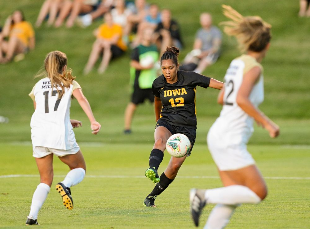 Iowa forward Olivia Fiegel (12) passes the ball during the first half of their match against Western Michigan at the Iowa Soccer Complex in Iowa City on Thursday, Aug 22, 2019. (Stephen Mally/hawkeyesports.com)