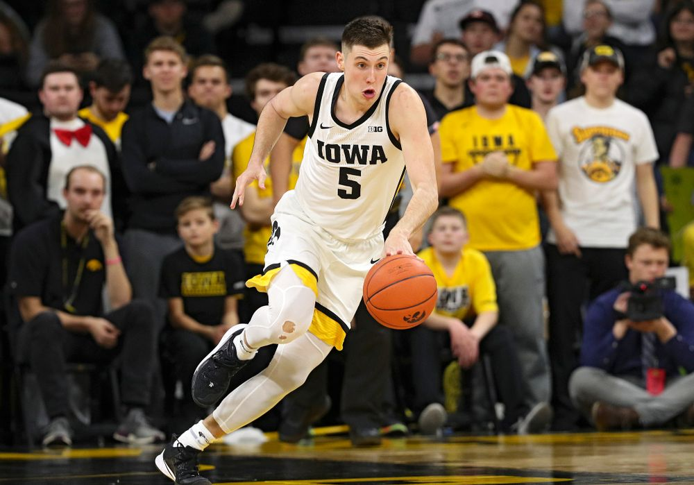 Iowa Hawkeyes guard CJ Fredrick (5) pushes the ball down the court during the second half of their game at Carver-Hawkeye Arena in Iowa City on Friday, Nov 8, 2019. (Stephen Mally/hawkeyesports.com)