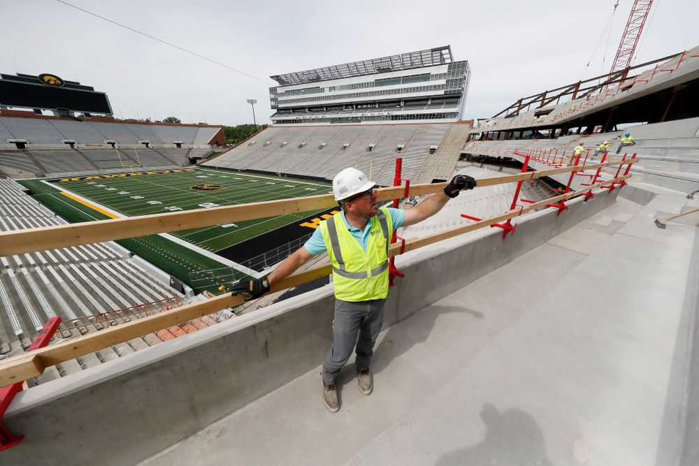 University of Iowa Senior Construction Project Manager Michael Kearns talks about the outdoor seating on the club level of the north end zone Wednesday, June 6, 2018 at Kinnick Stadium. (Brian Ray/hawkeyesports.com)