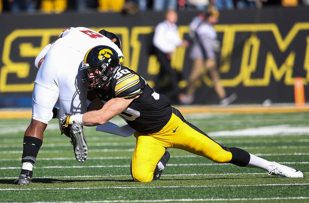 Iowa Hawkeyes defensive back Jake Gervase (30) makes a tackle during a game against Maryland at Kinnick Stadium on October 20, 2018. (Tork Mason/hawkeyesports.com)