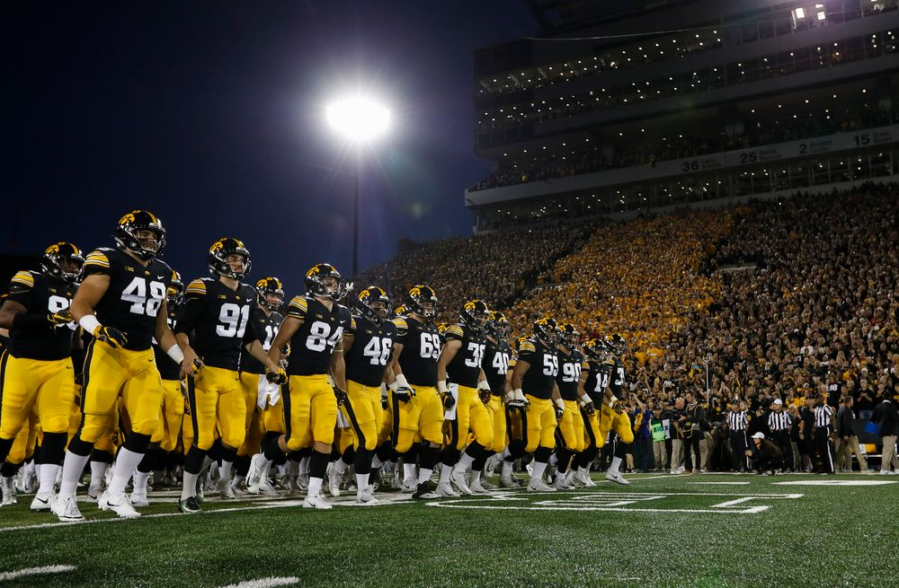 The Iowa Hawkeyes football team swarms the field before a game against Wisconsin at Kinnick Stadium on September 22, 2018. (Tork Mason/hawkeyesports.com)