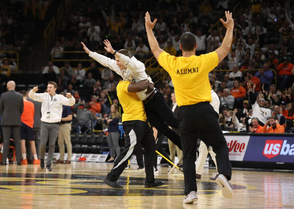 A fan celebrates after making a half court shot during the Iowa Hawkeyes game against the Illinois Fighting Illini Sunday, January 20, 2019 at Carver-Hawkeye Arena. (Brian Ray/hawkeyesports.com)