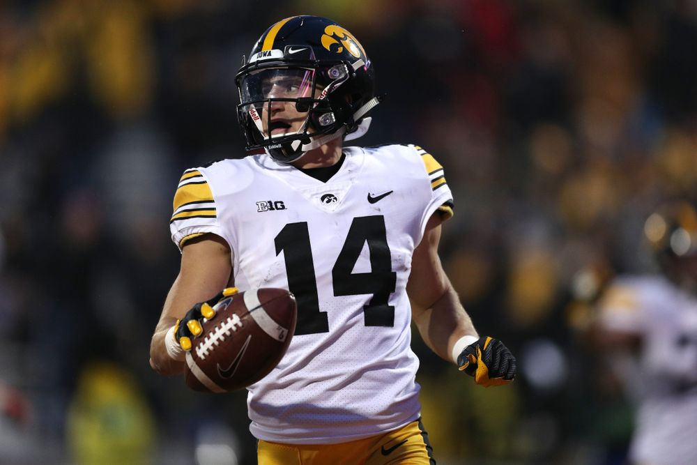 Iowa Hawkeyes wide receiver Kyle Groeneweg (14) returns a punt for a touchdown against the Illinois Fighting Illini Saturday, November 17, 2018 at Memorial Stadium in Champaign, Ill. (Brian Ray/hawkeyesports.com)