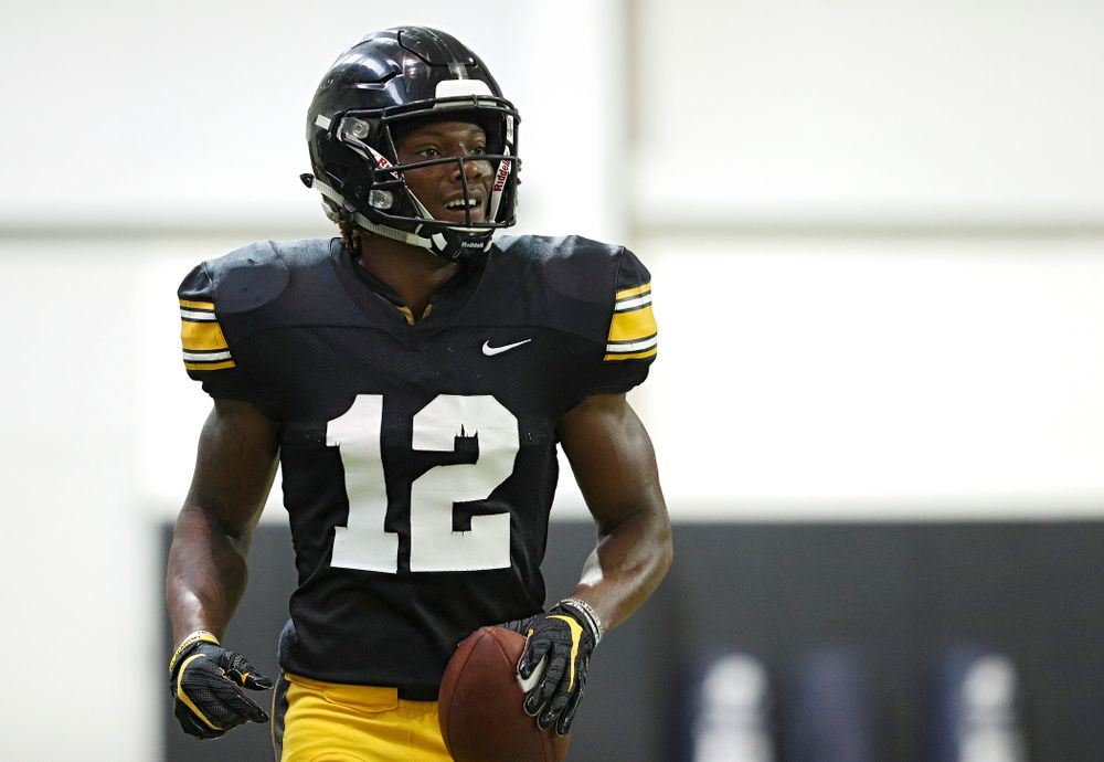 Iowa Hawkeyes wide receiver Brandon Smith (12) smiles after pulling in a pass during Fall Camp Practice No. 6 at the Hansen Football Performance Center in Iowa City on Thursday, Aug 8, 2019. (Stephen Mally/hawkeyesports.com)