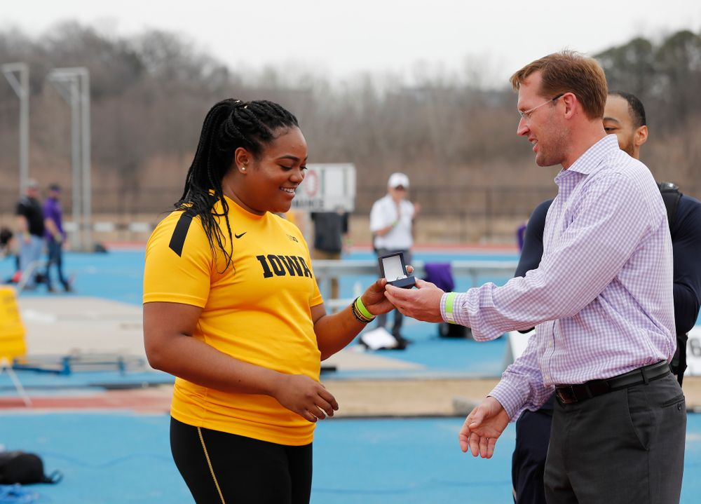 Iowa's Laulauga Tausaga and Aaron Mallett receive their Big Ten Championship rings  during the 2018 MUSCO Twilight Invitational  Thursday, April 12, 2018 at the Cretzmeyer Track. (Brian Ray/hawkeyesports.com)