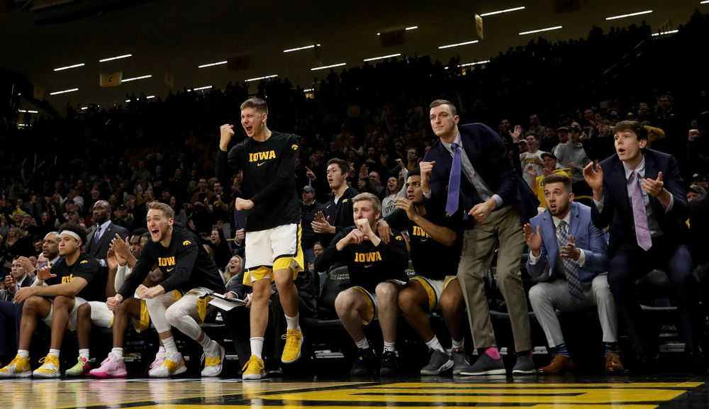 Iowa Hawkeyes guard Austin Ash (13) pumps his fist on the bench against the Michigan Wolverines Friday, January 17, 2020 at Carver-Hawkeye Arena. (Brian Ray/hawkeyesports.com)
